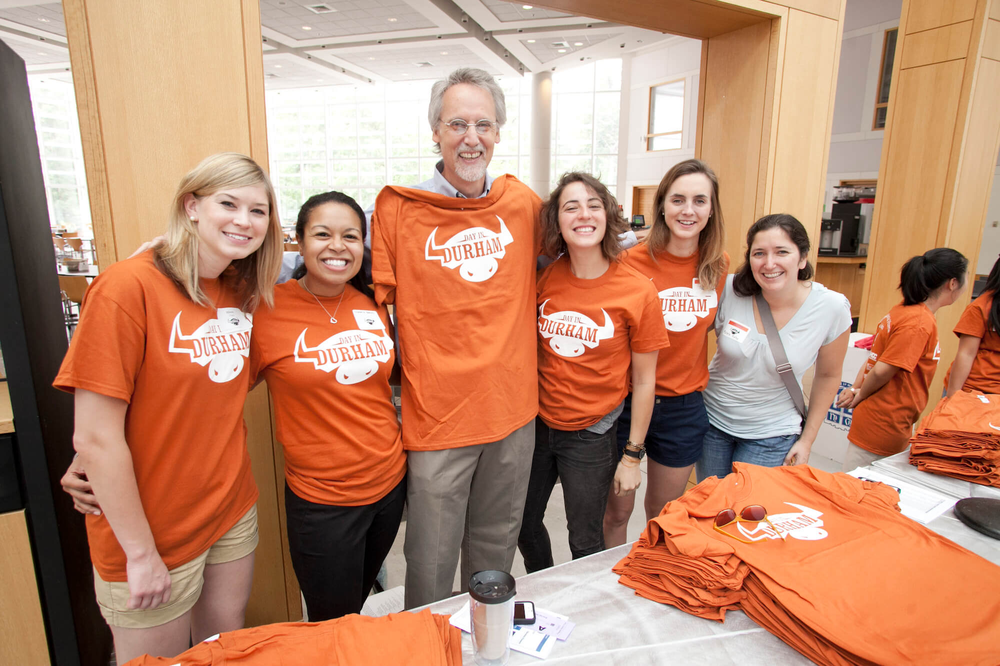 Bill Boulding and students with Durham t-shirts