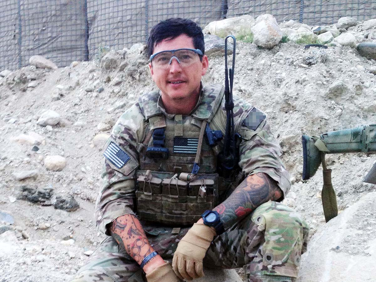 Veteran in military attire during active duty in the field prior to beginning his MBA