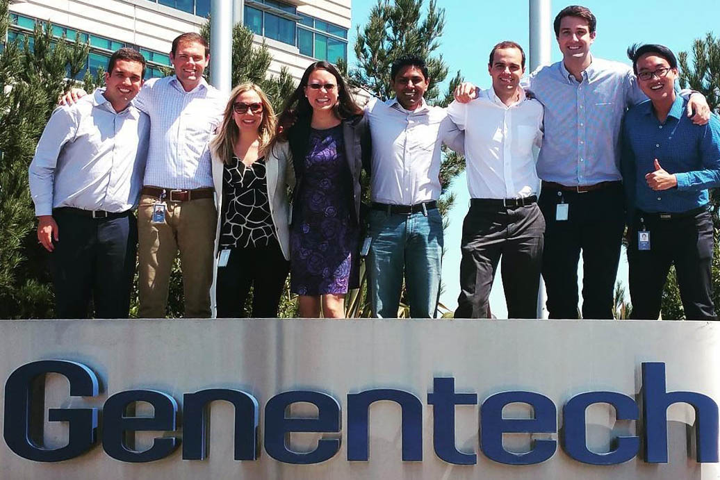 8 MBA summer interns pose behind the Genentech sign