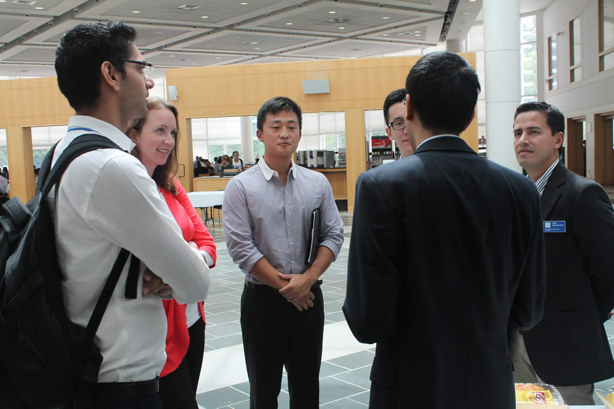 Students connecting with a company representative during the Finance Intensive