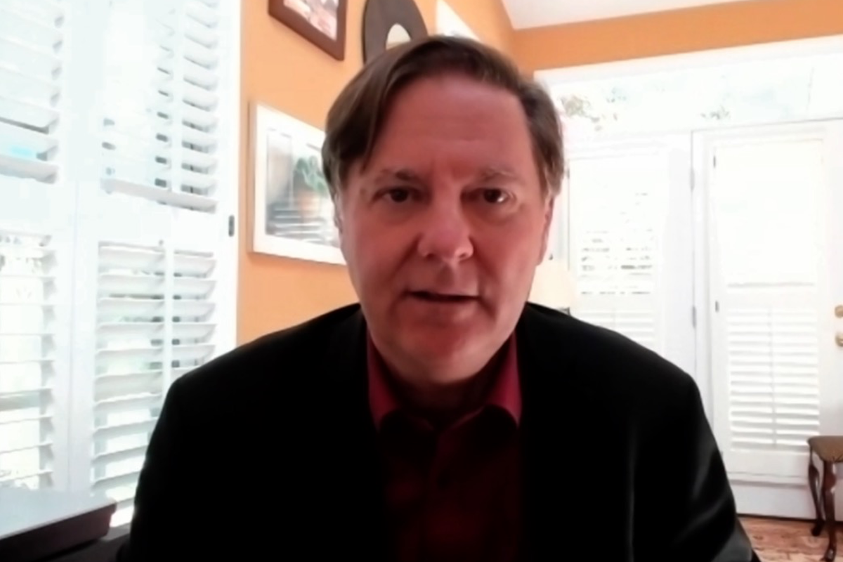 Screen grab of Campbell Harvey speaking in his home office.