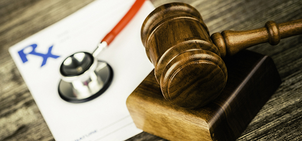Photo of prescription, stethoscope, and gavel