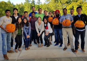 Students holding carved pumpkins for Halloween