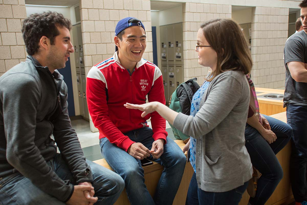 Students chat in Fuqua's mallway between classes